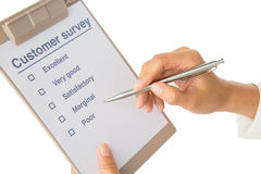 Hand fills out customer survey Royalty Free Stock Images