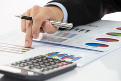Hand with finance report. And accounting business Stock Photos