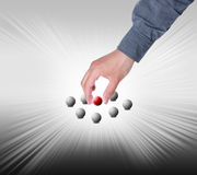 Hand find select ball in group Stock Photography