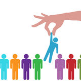 Hand find select person in line of people. A hand to reach find select a person from a row of people Stock Photo