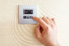 Hand with finger on air conditioner switch control Royalty Free Stock Photography