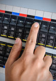 Hand with finger on circuit breaker switch Royalty Free Stock Images