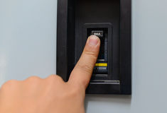 Hand with finger on circuit breaker switch Royalty Free Stock Photos