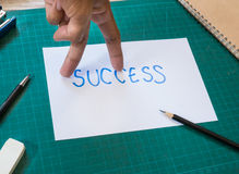 Hand finger look like walking action on success text paper. Royalty Free Stock Images
