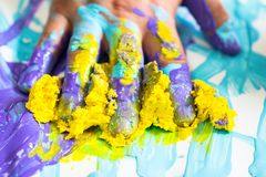 Hand and finger messy with purple and yellow paint. Hand and finger messy and dirty with purple and yellow paint as house work decorater or artist background and Royalty Free Stock Images