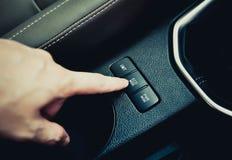 ECO mode button. Hand finger press button eco mode inside car royalty free stock image