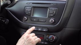 Hand finger pressing pushing button on car disable stabilization: Traction Control System off. Hand finger pressing pushing button on car disable stabilization stock video