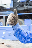 Hand and finger sign. Worker show his thumb in grunge cloth glove for liked sign, mean good or like Royalty Free Stock Images