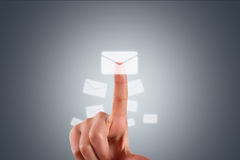 Hand Finger Touching Modern Email Button. Communication concept, young female hand finger touching, pressing modern email button on digital screen interface on Royalty Free Stock Photos