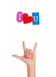 Hand with fingers forming love sign and I love you hanging tags Royalty Free Stock Image