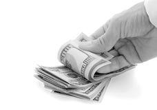 Hand fingers money. Hand fingers pile of dollars Stock Image