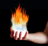 Hand on fire Stock Images