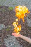 Hand in the fire without burning, close-up. Royalty Free Stock Photo