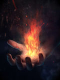 Hand on fire Stock Image