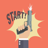 Hand firing a gun with start word Royalty Free Stock Image