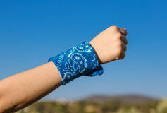 Hand with fist and blue bandana Royalty Free Stock Photography