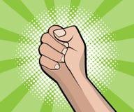 Hand fist revolution pop art, comic book background Royalty Free Stock Photos