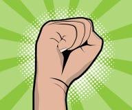 Hand fist revolution pop art, comic book background Royalty Free Stock Photo