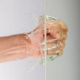 Hand (fist) with splashing water Royalty Free Stock Photography