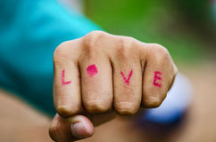 Hand fist write love Royalty Free Stock Photos