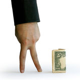Hand with a five dollars Royalty Free Stock Images