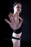 Hand with five thumbs. Attractive caucasian girl showing hand. Image isolated on black background Stock Photography