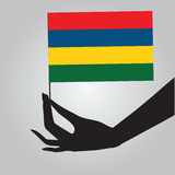 Hand with flag Mauritius Stock Photography