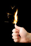 Hand with flame Stock Photography