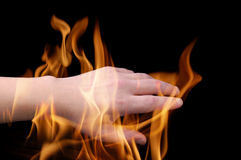 Hand in flame Stock Image