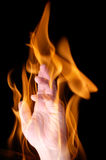 Hand in flame Royalty Free Stock Images