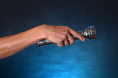 Hand with Flashlight Stock Image