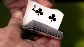 Hand flicking through deck of cards Royalty Free Stock Photos