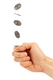 Hand flipping a coin Stock Image