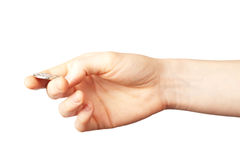 Hand flipping a coin. A hand about to flip a coin, isolated on white. A concept of luck, chance or taking a decision royalty free stock images