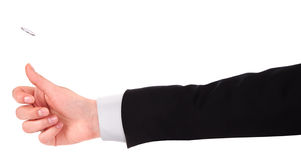 Hand flipping a coin isolated Royalty Free Stock Photo