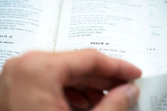 Hand flipping the Psalm 39 with shallow DOF Royalty Free Stock Photos