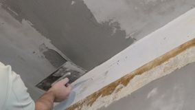 Hand with float aligns the ceiling with plaster stock footage
