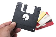 Hand with floppy disk. Isolated on a white background Stock Photo