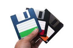 Hand with floppy disks. Isolated on a white background Stock Photo