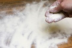 Hand with flour Stock Image