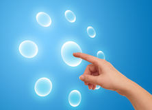 The hand on the flow of several button Royalty Free Stock Images