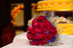 A hand flower bouquet in a table top setup. Royalty Free Stock Images