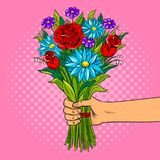 Hand with flowers pop art vector illustration. Hand holds bouquet of flowers pop art retro vector illustration. Comic book style imitation Royalty Free Stock Images