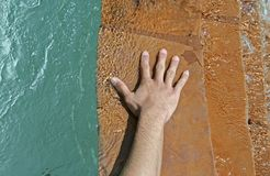 Hand On Flowing Water. Man's hand on flowing water Royalty Free Stock Photography