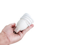 Hand and fluorescent lamp Royalty Free Stock Photo