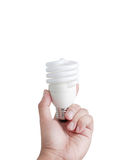 Hand and fluorescent lamp isolated Royalty Free Stock Images