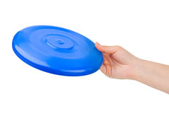 Hand and flying disc Stock Images