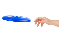 Hand and flying disc Stock Photo