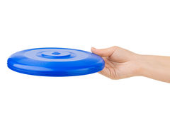 Hand and flying disc Royalty Free Stock Images