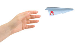 Hand and flying mail plane Royalty Free Stock Photography